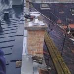 kémény a tetőről háttérben a Teleki térrel